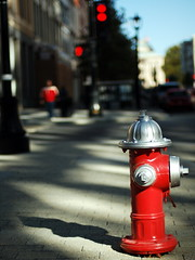 Synchronicity in Red (bitzcelt) Tags: shadows bokeh raleigh dontwalk redshirt redlights redhydrant nikkor50mmf14 hbw bitzcelt