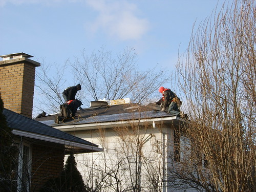 The Roofers at Work