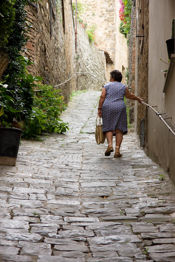tuscany: lady walking up the street
