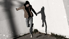 Kickin' it by myself (jonnycrush) Tags: shadow portrait selfportrait hat wall jump jumping action coat jeans jacket walls ih jumped timefreeze aplusphoto