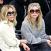 Mary-Kate Olsen and Ashley Olsen attend the Chanel Fashion show