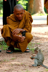 A monk with a camera phone (kees straver (will be back online soon friends)) Tags: cameraphone travel portrait people orange temple monkey asia cambodia buddha buddhist religion monk buddhism ankor keesstraver
