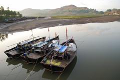 Boats at sunrise (Nik Man) Tags: morning india sunrise boats early fishing nikon maharashtra janjira konkan d60 calmwater