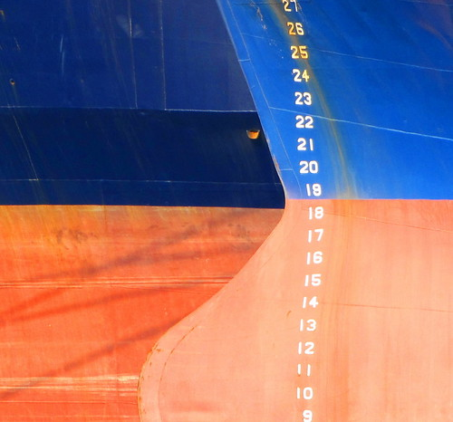 abstract photograph blue and orange ship boat hulls