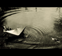 let's go sailing.. [72/80] [EXPLORED] (Colin/Murphy) Tags: plants white lake black water creek paper boat nikon bars sailing bokeh text small mini f sail ripples mm splash 18 50 d40