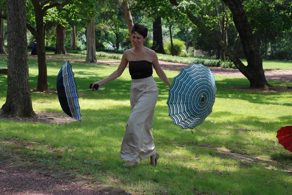 this is my favorite wedding image of me (I'm chasing down skittering antebellum umbrellas)