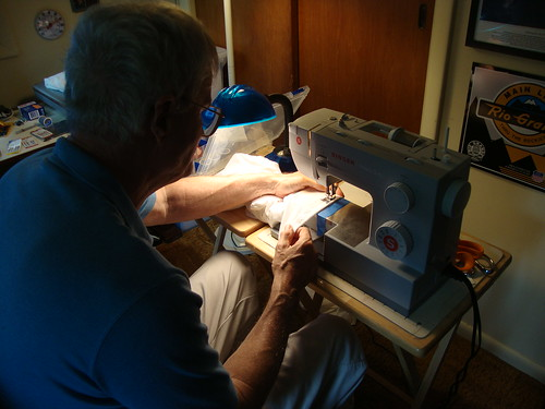 my dad, sewing