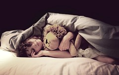 The lion sleeps tonight. (olivia bee) Tags: girl kid bed child lion sheets pillow stuffedanimal teenager nostalgic past duvet nostagia teenagephotographer oliviabee