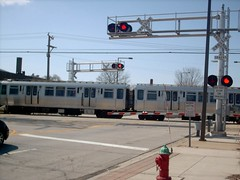 Southbound CTA Yellow line / Skokie Swift train crossing Main Street. Skokie Illinois USA. April 2007.