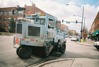 City of Chicago Department of Streets and Sanitation street sweeper vechicle heading westbound on Montrose Avenue. Chicago Illinois. January 2006.