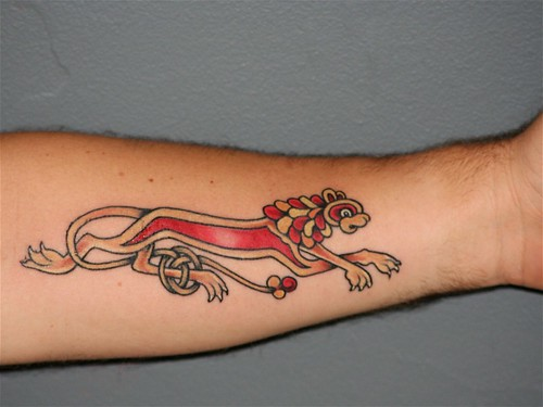 Leo Zodiac Tattoo Ideas: Fire Another great theme that can be used alone to