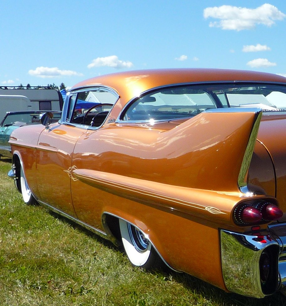 Orange 1958 Cadillac. go back