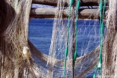 reti (HiSpAnIcO[reloaded]) Tags: sea canon eos fishing mare hole web da pesca buchi filo rete reti supershot aforisma 450d abigfave aplusphoto canoneos450d goldenheartaward