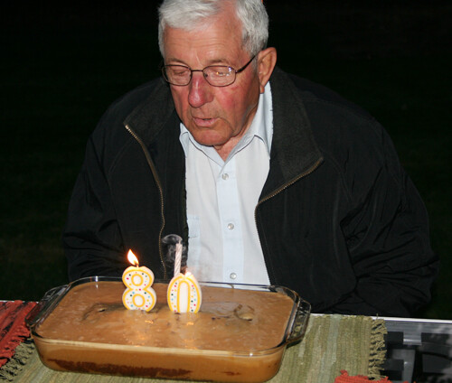 Grandpa blows out the candles