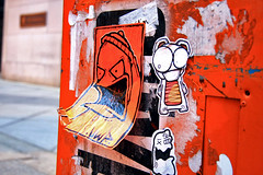 """Dezoe """"Bwaaaaa ha ha, you look stoopid in that hat"""" / Ticky """"erm, you ought not laff at pirate... he might take your head off"""" / UWP """"keep laffing you tit, I'll put you through a woodchipper!!!"""" (damonabnormal) Tags: nov street city november urban streetart art philadelphia canon graffiti sticker 33 label stickers urbanart labels mon slap grime monday 2008 phl 08 slaps uwp ticky citystickers philadelphiastreetart 40d philadelphiagraffiti tickytock philadelphiaartist dezoegrime1"""