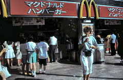 gm_02201 Tokyo, McDonald's Take-out Counter 1983 (CanadaGood) Tags: tokyo analog 1983 mcdonalds slidefilm japan 日本 東京 tōkyō japanese kodachrome restaurant sign slidecube red yellow colour color white fashion streetphoto building person people asia canadagood eighties advertising text