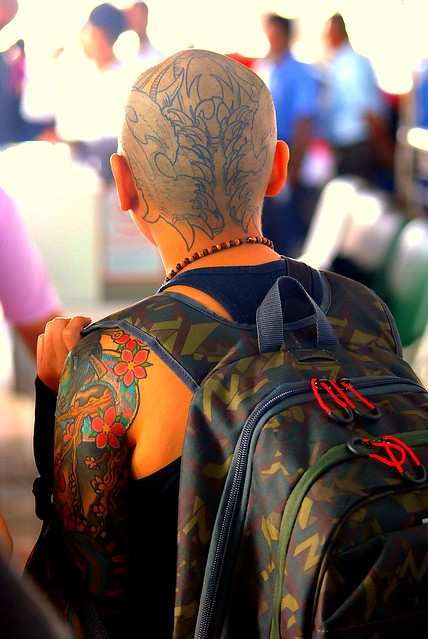 Skinhead Tattoo. This head will soon be as colorful as his arm.