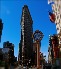 Its Time for a new week...... (ineedathis, the older I get, the more fun I have!) Tags: city nyc blue sky newyork building cars architecture skyscraper downtown traffic manhattan perspective earlymorning americanflag fifthavenue redlight flatironbuilding hbm nikond80 fifthavenuebuildingclock 285feet87meterstall