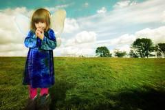 Fairy princess in blue dress. (godogo) Tags: blue sky girl field grass wings princess queen fairy fairyprincess bluedress