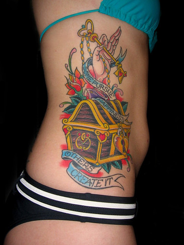 tattoo on girls side. Colorful girls side tattoo