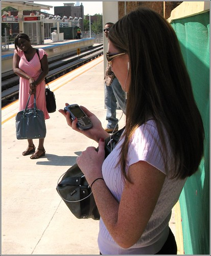 Photo of woman checking her smart phone for business listings