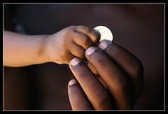 My money! [..Sylhet, Bangladesh..] (Catch the dream) Tags: baby money contrast coin hands child skin affection fingers closeness taka sylhet bangladesh gettyimagesbangladeshq2