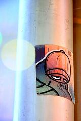 giving passerby the evil eye (damonabnormal) Tags: street city urban streetart art philadelphia canon graffiti sticker 33 label stickers september urbanart labels philly slap 2008 phl 08 215 slaps uwp citystickers streetstickers philadelphiastreetart 40d philadelphiagraffiti philadelphiaartist