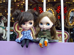 Blousey and Sadie take a break by the carousel.
