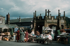Street Market + Covered Market Cross, Kirkby Lonsdale (1958) (The Douglas Campbell Show) Tags: uk england building person town vehicle fruitveg westmorland kirkbylonsdale