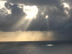 Hout Bay sunset (Vilseskogen) Tags: ocean africa park light sunset cloud mountain rain weather table southafrica hope coast town ray good south creative commons atlantic national shore creativecommons cape capeofgoodhope tablemountainnationalpark vilseskogen