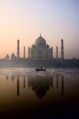 Taj Mahal, Agra, India (Jitendra Singh : Indian Travel Photographer) Tags: camera morning travel blue winter boy sky people sunlight india white black reflection building art monument boys water fog stone river boat memorial paradise cityscape colours photographer photos stones tripod transport fine wide taj tajmahal agra bluesky tourist worldheritagesite textures cpc backpack marble calligraphy marvel oldbuilding boatman pradesh muslimculture mughal uttarpradesh travelphotography jitendra yamuna reflectionsonwater 5photosaday mumtaj fineartphotos travelphotographer silhutte anawesome jitendrasingh lifeinindia theunforgettablepictures jitens concordians betterthangood theperfectphotographer alemdagqualityonlyclub qualityonly iloveyouindia sendstone sahajahan shahjahanandmumtajmahal wwwjitenscom