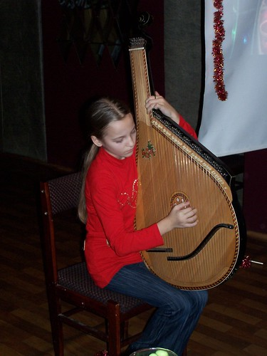 Kristina playing the bandura and singing
