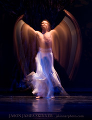 Stage Angel (skinr) Tags: longexposure blue orange abstract reflection blackbackground angel cross fineart performance 101 motionblur fabric crucifix paintingwithlight onstage angelic chaz dressrehearsal brethren whiteskirt canonef50mmf14usm maledancer motiontrails darkbackground fineartphotos canoneos40d canon40d wwwjskinnerphotocom jasonjamesskinner choreographerbernardgaddis thelasvegascontemporarydancetheater choreographerbernardhgaddis lvcdt whitecuffs