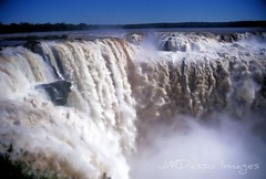 Iguazu (JMDasso) Tags: travel brazil sky sun holiday southamerica nature water argentina beautiful rock brasil wow river waterfall amazing rainbow shine hole south jose falls falling helicopter iguazu dasso josedasso