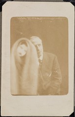 Man with a female spirit (National Media Museum) Tags: portrait man sepia mask spirit doubleexposure ghost fake tie moustache jacket medium cloak mmmmm paranormal occult seated cloke espectro fantasma espirito spiritualist spiritphotograph nationalmediamuseum commons:event=commonground2009