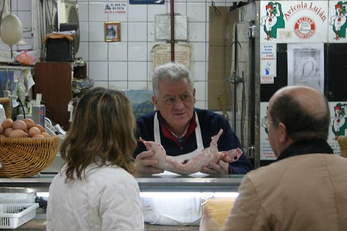 Victor Hugo, the butcher, selling a rabbit at Mendoza's Mercado Central