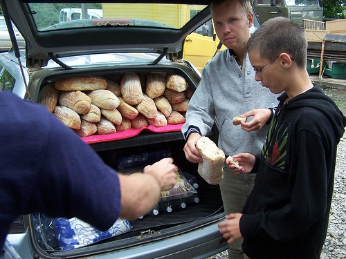 Sampling some of the fresh bread that was bought to hand out