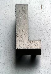 Wet Aluminum Capital Letter L (Washington, DC) (takomabibelot) Tags: rain geotagged washingtondc dc aluminum letter l ll oneletter 1707 majuscule lstreetnw geo:lat=38903812 geo:lon=77039174