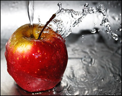 Apple & Water - Keeps you Healthy (Prof EuLOGist) Tags: apple water drops nikon sink maldives experimenting selectivecolor jinan hussain flickrsbest superaplus aplusphoto