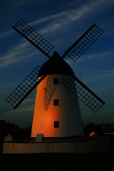 Lytham Windmill At Dusk (Ian Lambert) Tags: blue light sky sun windmill set river evening coast shadows dusk lancashire lytham preston blackpool lancs fylde ribbleestuary goldmedalwinner platinumheartawards goldstaraward goldenmasterpiece ribbleestuarydusk