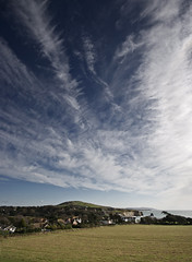 Spine - Cirrus skies over Freshwater Bay, Isle of Wight (s0ulsurfing) Tags: blue light sky cloud sunlight beach weather clouds island bay coast skies bright wind patterns wide wideangle coastal vectis isleofwight coastline 2008 isle wight cirrus freshwater westwight 10mm freshwaterbay sigma1020 s0ulsurfing thecloudappreciationsociety
