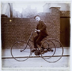 Young lad on an early tricycle