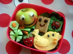 Smiley toddler bento (LoveBones) Tags: red food green bird apple yellow cheese lunch strawberry toddler chocolate cucumber sandwich raisins smiley olives ladybug bento carrots whitechocolate