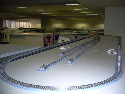 Model train setup over cubicle walls