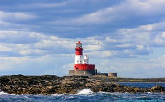 For those in Peril on the sea... (law_keven) Tags: ocean blue england sky lighthouse house clouds islands waves atlantic northumberland trinity farne gracedarling cloudage explore500 longstonelighthouse outerfarne