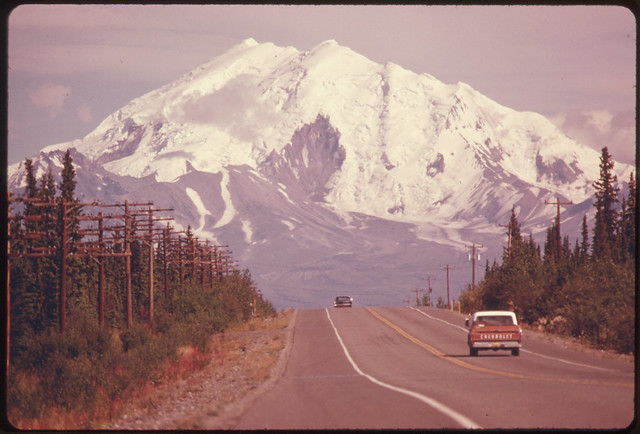 View East Along Glen Highway Toward Mount Drum (Elevation 12002 Feet) and Intersection of Road and Trans-Alaska Pipeline081974 by The US National Archives