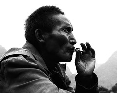 Man smoking, Yangshuo (mexadrian) Tags: china mountains mediumformat yangshuo cigarette smoking 67 plaubel makina