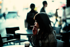 smoker (moaan) Tags: leica portrait woman digital 50mm cafe dof bokeh candid smoke m8 2008 stabucks throughthewindow f095 explored canonf095 leicam8 canon50mmf095 bokehwhores gettyimagesjapanq1 gettyimagesjapanq2