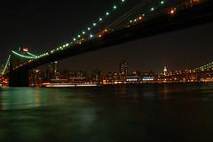Bridging The River (RichGreenePhotography.com) Tags: new york nyc newyorkcity longexposure sky water skyline brooklyn night lights nikon skyscrapers manhattan brooklynbridge hero manhattanbridge eastriver winner empirestatebuilding soe 4846 d80 capturenx2 richgreenephotography