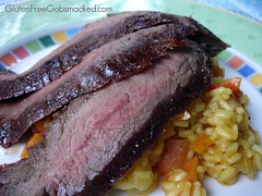 Chile-rubbed flank steak with saffron rice